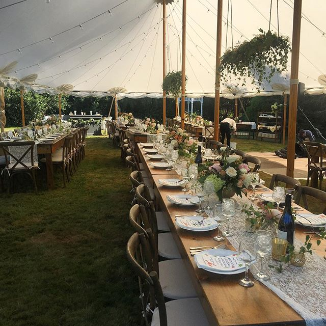 Decorated wedding tents set up outside